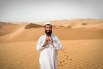 Jeffris Elliott: Afghan Praying in Desert, 2008
