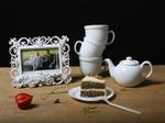 Justine Reyes: Still Life with Tea Set, Picture Frame and Cake, 2009